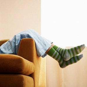 Resting on the Couch --- Image by © Flint/Corbis